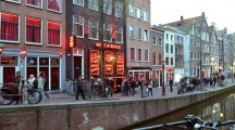 Amsterdam, The Netherlands - April 04, 2014: Red Light District in Amsterdam. Evening View Of Amsterdam Canals.
