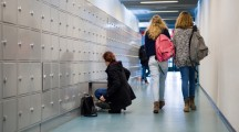 ENSCHEDE, THE NETHERLANDS - 02 FEB, 2015: Students are walking through a hallway with lockers on a high school