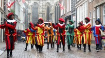 DORDRECHT, THE NETHERLANDS - NOVEMBER 17: Dancers dressed as Zwarte Piet participating in a parade celebrating the arrival of Saint Nicholas on November 17, 2012 in Dordrecht, Netherlands.
