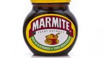 SWINDON, UK - FEBRUARY 18, 2014: Jar of Marmite on a white background