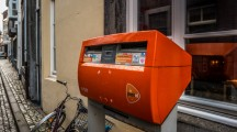 MAASTRICHT, NETHERLANDS - JANUARY 16, 2016: Orange mailbox postal service of the Netherlands.