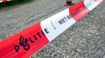 HAAKSBERGEN, NETHERLANDS - JUNE 09: Cordon tape from the dutch police is marking a crime scene and forbidden to pass, june 09, 2011 in the Netherlands